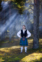 Man in scottish costume in the forest