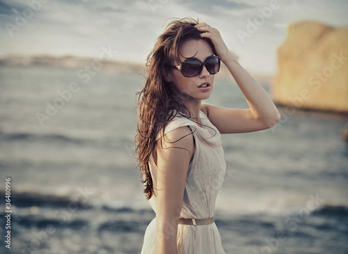Cute woman wearing sunglasses