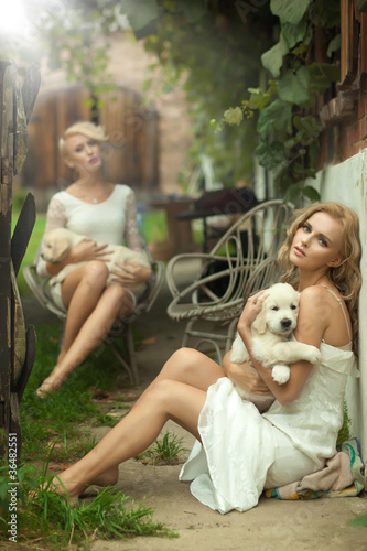 Two beauty ladies with cute puppies