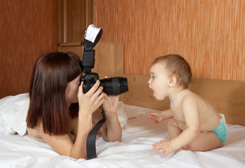 mother with baby takes photo