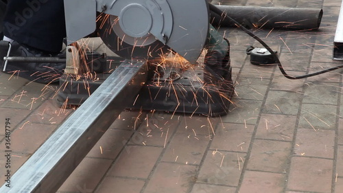 steel gets cut with sparks fly