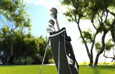 Golf equipment on green grass meadow field with trees