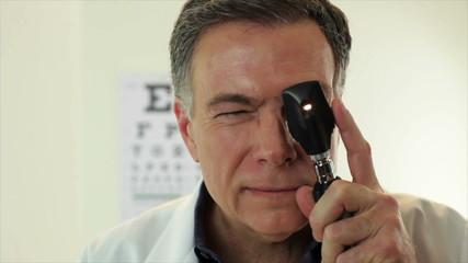 Optometrist POV checking patient