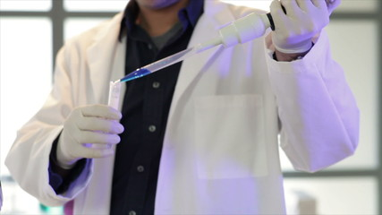 Chemist Using a Pipette