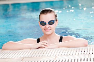 Woman in black goggles in swimming pool
