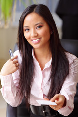 young beautiful asian woman in a business environment