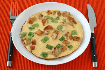 Omelet with meat and vegetables