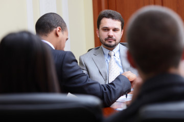 Mature businessman interviewing new people