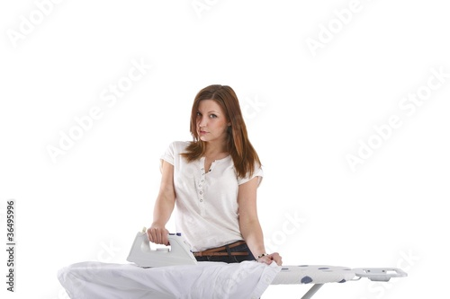 young woman ironing on ironing board (white background)
