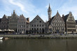 Houses of the Graslei in Belgiums city Gand reflect in the water
