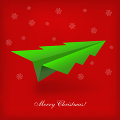 Concept of the Christmas tree and origami airplane