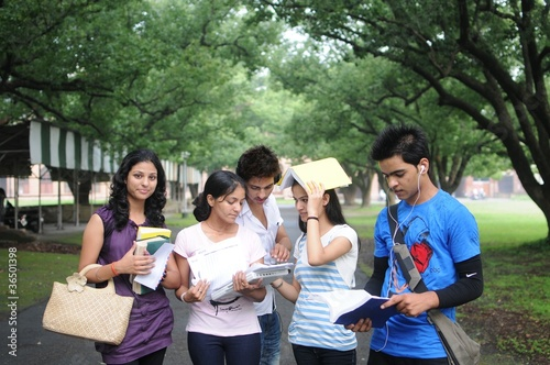 Group of Indian college students discussing a topic.