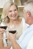 Fototapety Happy Senior Man & Woman Couple Drinking Wine at Home