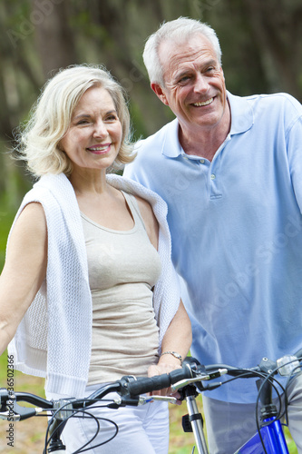 Happy Senior Man & Woman Couple Cycling Bicycles