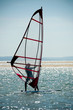 windsurfer on a sparkling blue sea