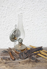 set of old dirty tools and old kerosene lamp