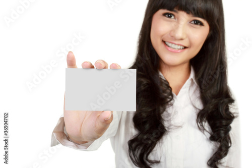 Businesswoman holding a blank business card