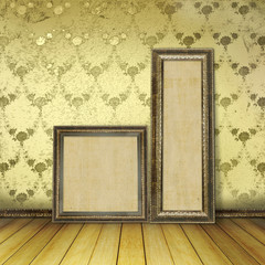 Wooden frames in the old room with the remains former luxury