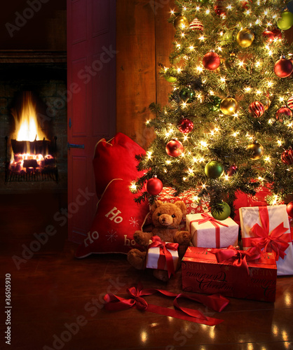 Christmas scene with tree and fire in background - 36505930