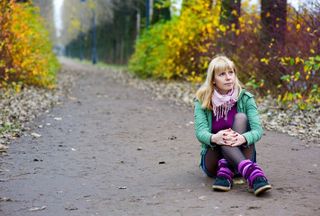 Woman sitting on the park road