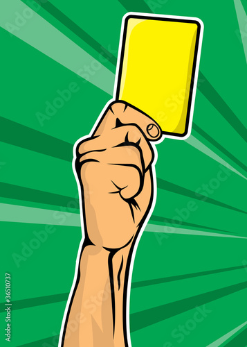 Soccer referee hand with yellow card