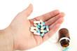 A hand holding pills