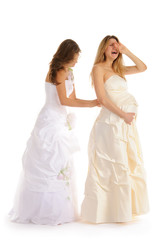 crying pregnant bride  with girlfriend