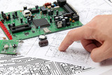 Electronic circuit boards on the background of electronic scheme