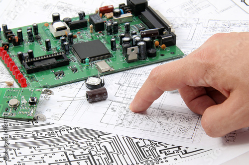 Electronic circuit boards on the background of electronic scheme - 36513121