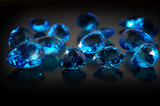 Group of topaz gemstones on dark background.