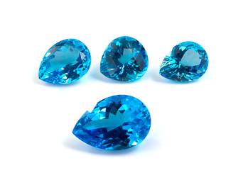 Group of topaz gemstones isolated on white.