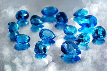 Group of topaz gemstones with artistic background.