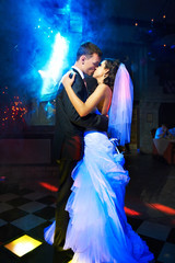Kiss and dance young bride and groom