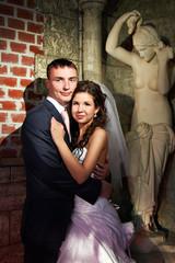 Happy bride and groom in antique interior