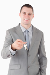 Portrait of a young businessman showing a set of keys