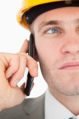 Close up of a young architect making a phone call