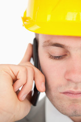 Close up of a sad architect making a phone call