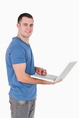 Portrait of a man using a laptop
