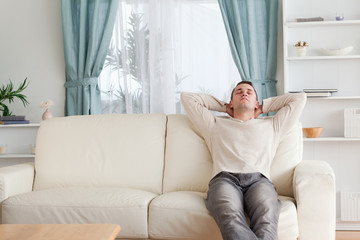 Man resting on a couch