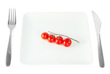 Cherry tomatoes on a white plate isolated on white background