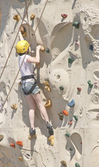 Rock Climbing Woman in Yellow Helmet