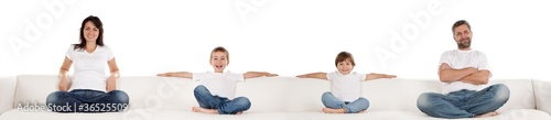 Family Sitting on White Couch