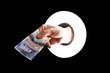 Hand withBritish twenty pound note