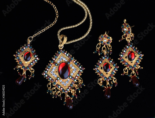 Intricate Indian Gold Jewelry On Black Backgrounds