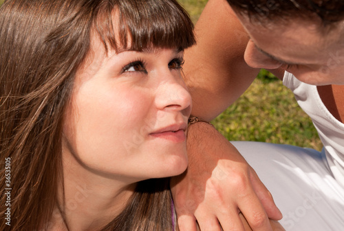 young couple happy sitting on grass, love relationship