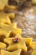Unbaked star-shaped cookies with colorful sugar sprinkles