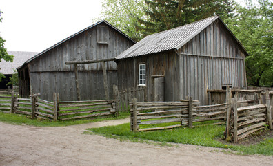 Old wooden cabins on a gravel street