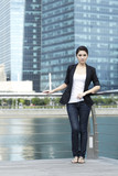 Business woman standing in front of office building