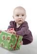 Постер, плакат: young baby with gift