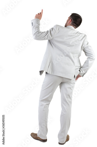 Back view of  thinking young business man in  white suit.